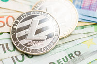 Litecoin and euro banknotes.