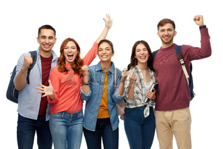 group of happy students celebrating success