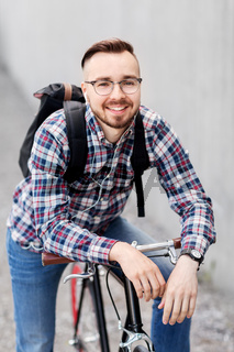hipster man with fixed gear bike and backpack