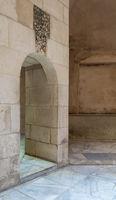 Aged narrow vaulted passage and stone bricks wall