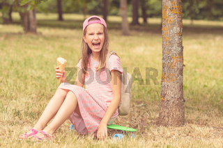 Girl laughing and holding ice cream