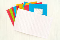 Pile of colored exercise books