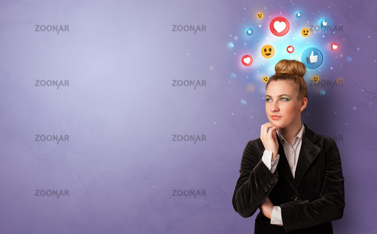 Business person standing with social media concept