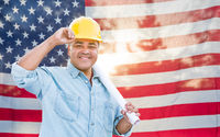 Hispanic Male Contractor with Blueprint Plans Wearing Hard Hat In Front of American Flag