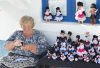 Woman selling traditional handmade dolls