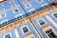 Close-up of a historic building facade in Porto's old town with the typical blue Azulejo tiles