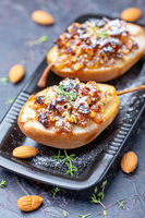 Pears baked in honey with raisins and nuts.
