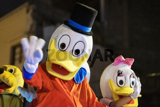 Tenerife, Spain - January 5, 2019: Disguised cartoon characters during Three kings parade celebration. Cabalgata de Reyes magos is a traditional epiphany Spanish celebration.