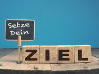 German words Set your Goal on wooden blocks