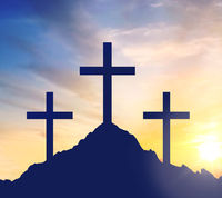 silhouettes of three crosses on calvary hill