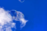 Soap bubbles in cloudy sky