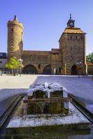 Fountain in front of  Hungerturm and Steintor Gate Bernau, Brandenburg, Germany