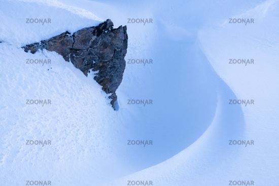 Rock with snow formation, Hasvik, Soeroeya Island, Finnmark, Norway