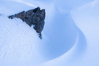 Rock with snow formation, Hasvik, Soeroeya Island, Finnmark, Norway