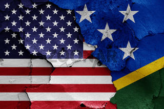 flags of USA and Solomon Islands painted on cracked wall