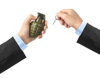 Hand pulls a check from a grenade