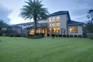 Luxury Home Exterior Dusk Dawn Night Lawn Sunset Interior Lights Turned on Horizontal Orientation Landscape Architectural