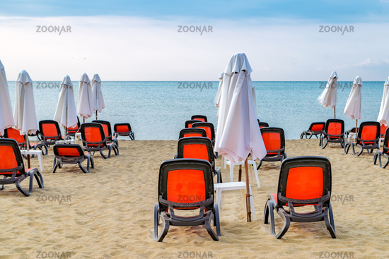 Chairs and umbrellas on a beautiful beach at sunrise in Sunny Beach on the Black Sea coast of Bulgaria