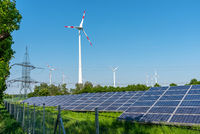 Solar panels, wind engines and an electricity pylon seen in Germany