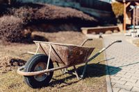 old rusty garden wheelbarrow