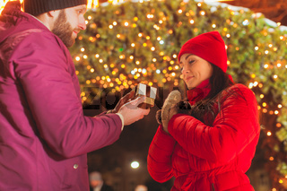 Side view of man making proposal of marriage on Christmas eve outdoors