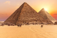 The Pyramid of Menkaure and the Pyramid of Khafre in the sunset rays, Giza desert