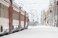 Russian train in the winter. The train on the platform. The train pulls up to the platform. Winter train. . Russia, Gatchina December 26, 2018