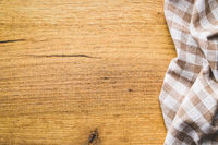 Checkered tablecloth over wooden table.