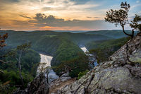 Landscape of canyon with river in sunset