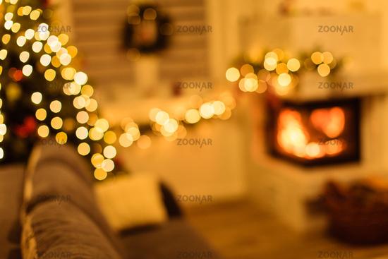 Christmas tree and home holiday decor on fireplace