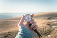 Compass in Hand Natural background .Vintage Tone