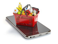 Smartphone and shopping basket with  food and drink. Online grocery supermarket concept.