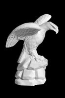 statue of an eagle on a black background