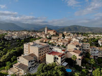 Aerial photography Campanet village spanish typical town with ancient houses old hillside architecture drone point of view, Balearic Islands, Palma de Mallorca, Spain