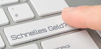 A keyboard with a labeled button - Easy Money - Schnelles Geld (German)