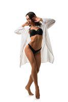 Slim brunette in black lingerie isolated shot