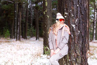 Woman in a snowy woodland of pine trees