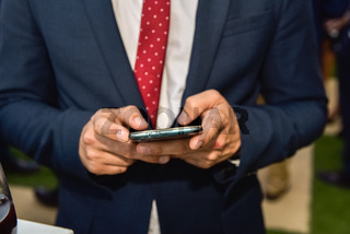 Businessman tradesman using his smartphone to communicate with his clients.
