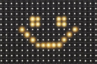 Dots matrix led diplay panel with illuminated symbol of smile face
