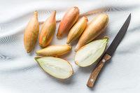 The golden shallot onion. Halved fresh bulbs