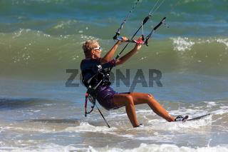 Kitesurfing or Kiteboarding