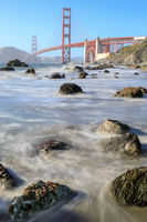View of the Golden Gate Bridge from Rugged Marshall Beach in High Tide.