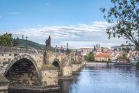 Charles Bridge on the side and Prague city