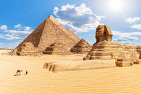 The Pyramids and the Sphinx in the sunny desert of Giza, Egypt