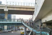 People crossing road bridge Shanghai