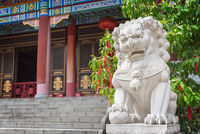 Lion white stone sculpture in a buddhist temple