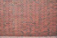Mauer aus roten Backsteinen als Hintergrund Textur