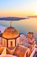 Church and Aegean sea at sundown