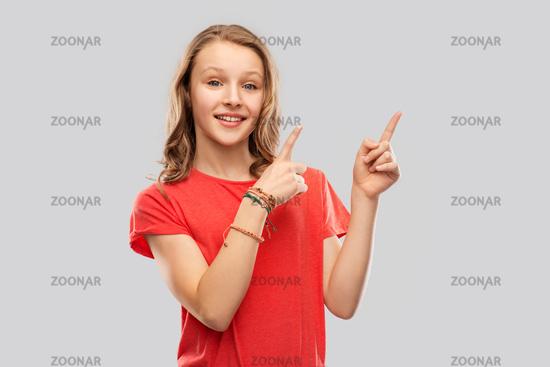 smiling teenage girl pointing fingers to something