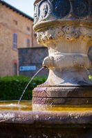 detail of medieval fountain Arquato castle Piacenza Italy